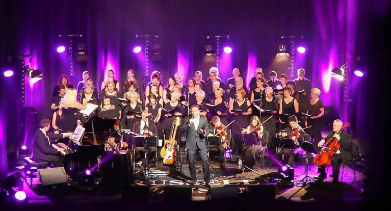 The Rising Voices choir performing with Russell Watson